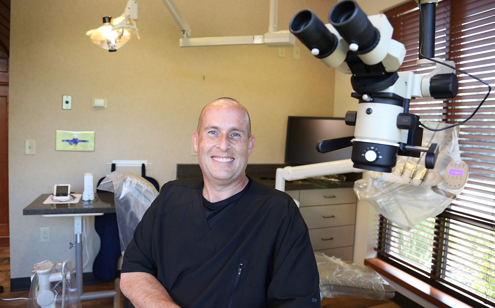 Marshall T. Lavin with microsope